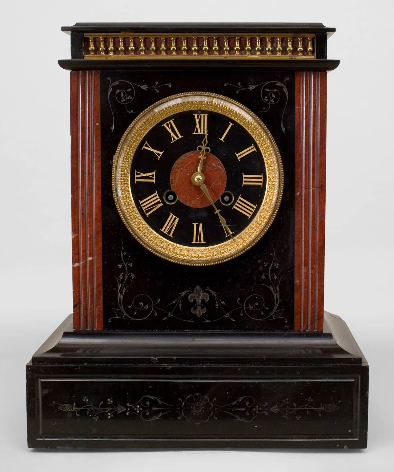 French black marble mantel clock with rosso antic marble column sides and a face numbered in etched and gilded roman numerals (Non-operational).