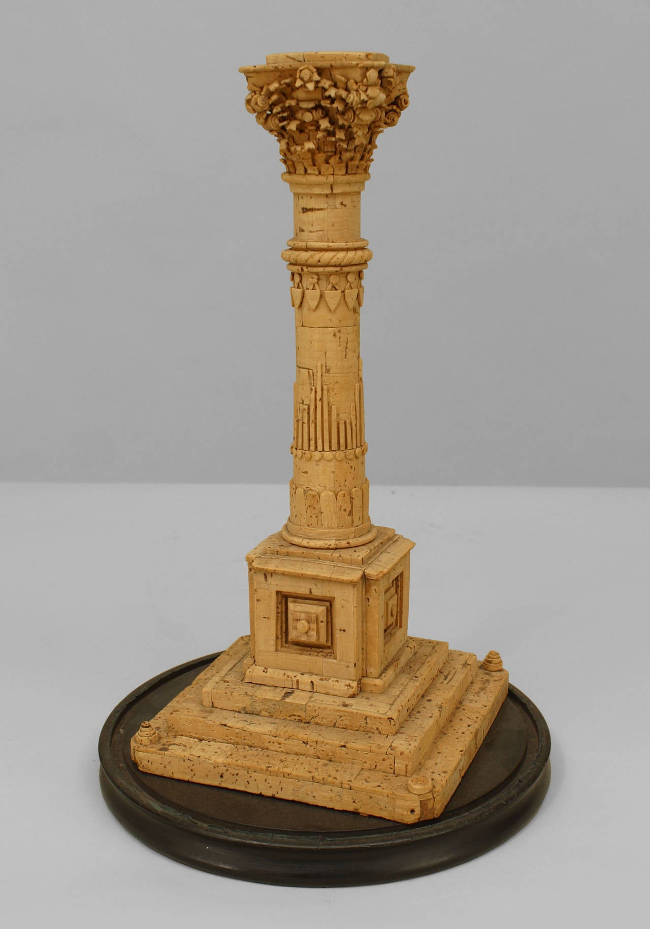 19th century Italian neoclassical cork carved model of a classical column with a Corinthian capital and resting on a stepped square base.