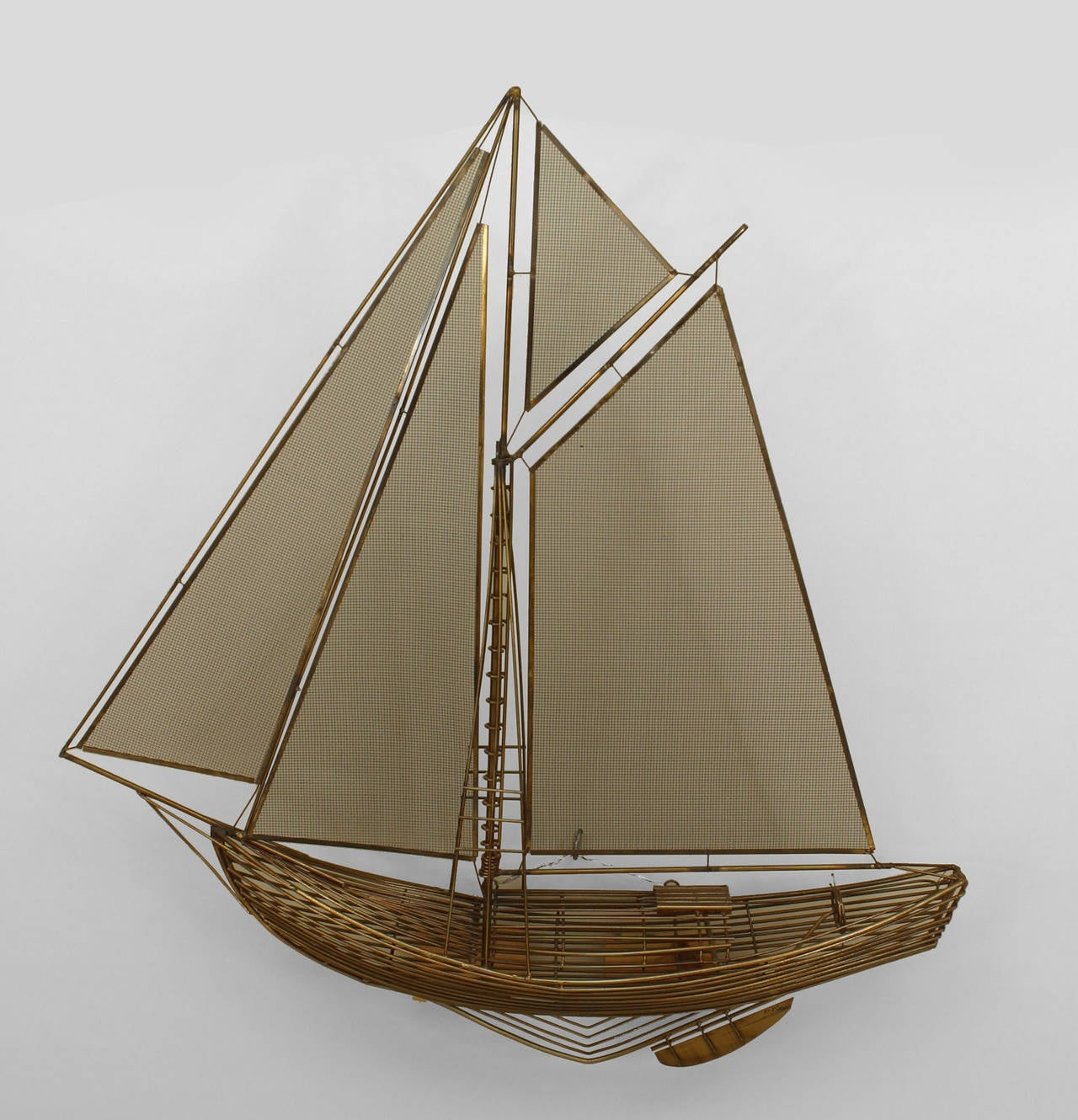 1980's American tubular brass design wall plaque of a sail boat with mess sails (signed: C JERE 1982).