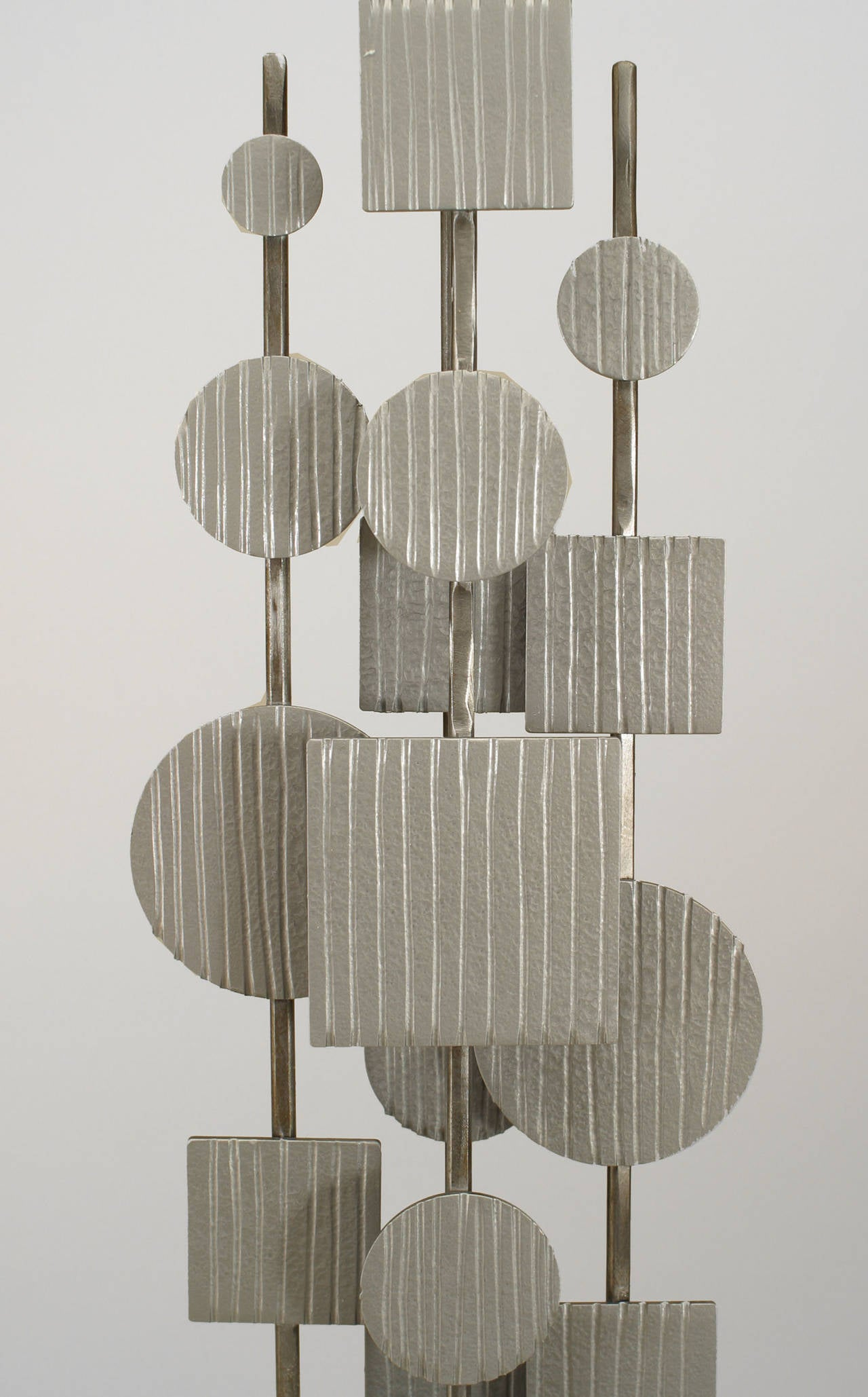 American Post-War Design abstract steel sculpture on a black rectangular base of vertically arranged circles and squares.