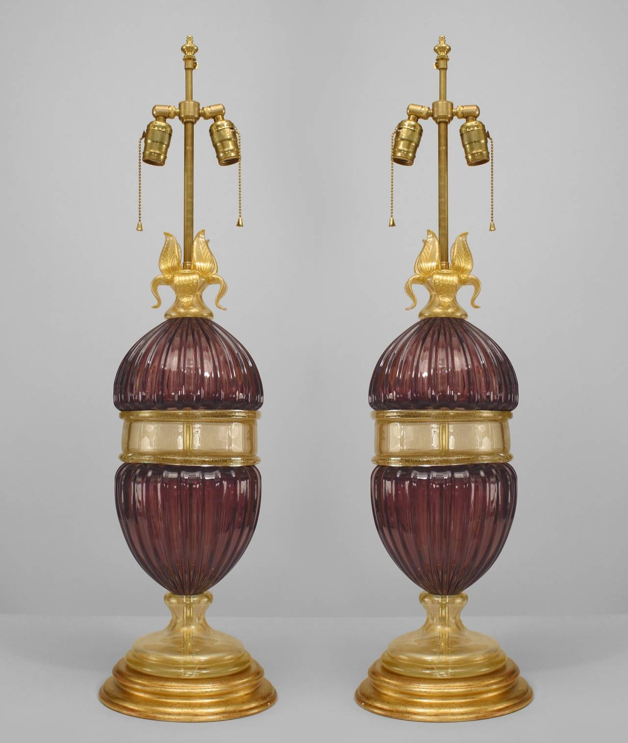 Pair of Italian Murano fluted amethyst glass table lamps, each with a gold-dusted glass center section, base and flower top (modern).
