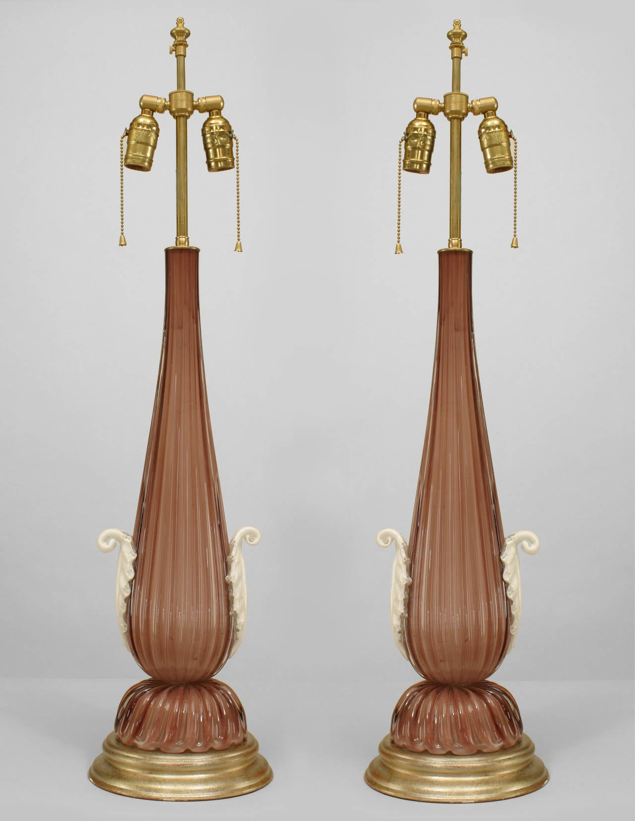 Pair of Italian Murano amethyst overlay glass table lamps with fluted tapered forms on scalloped bases with applied white glass leaf sides (modern).