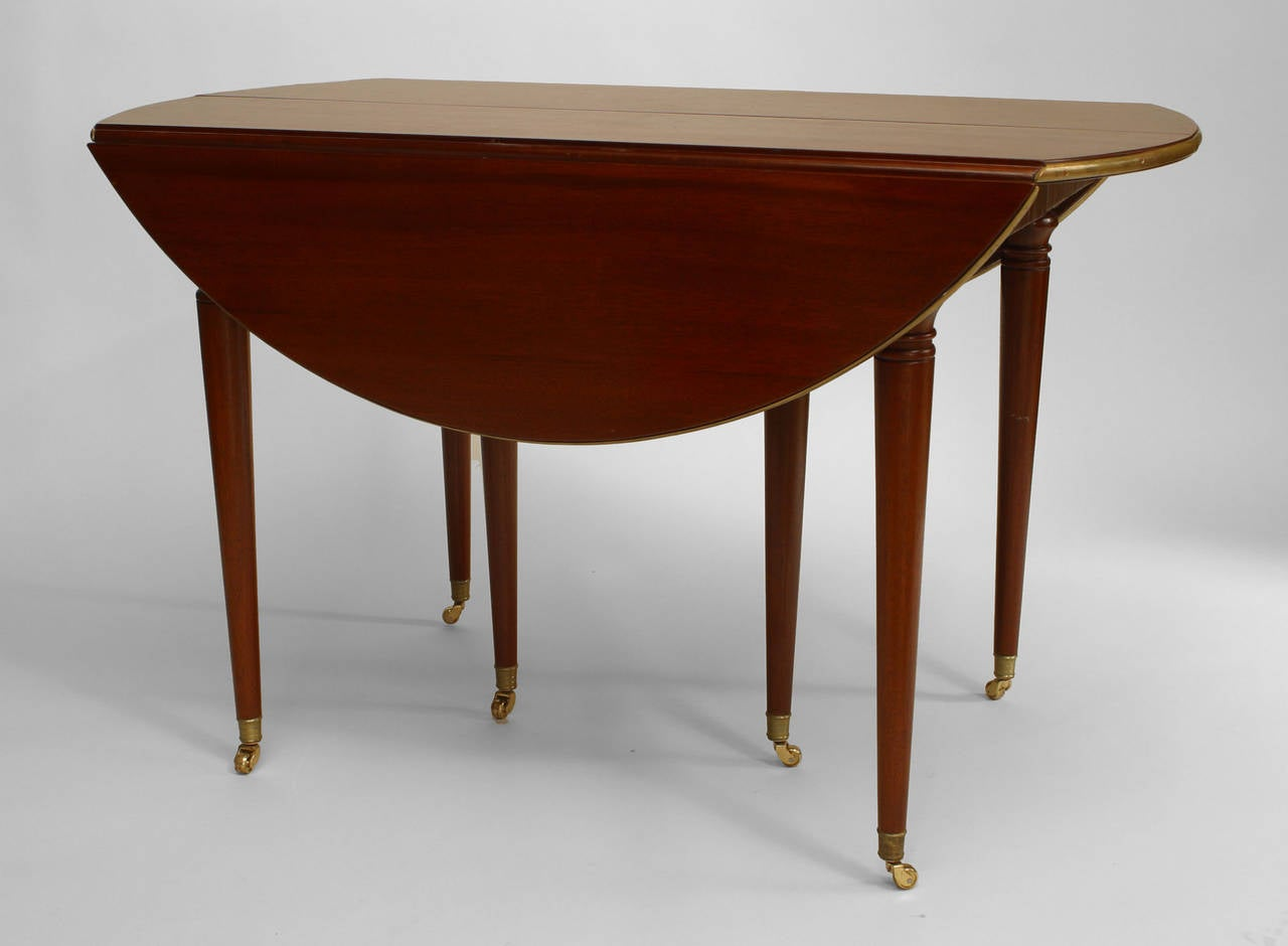 to 19th century french louis xvi style expanding mahogany dining table
