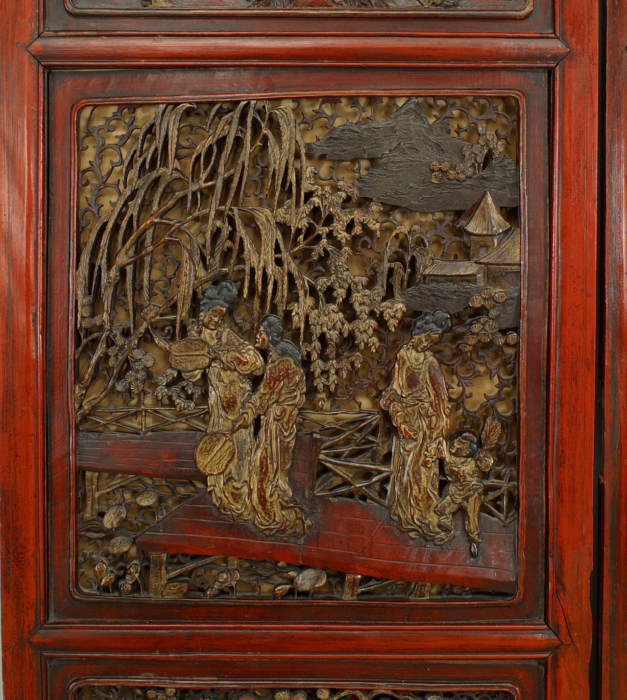 Pair of Chinese door panels with five pairs of carved natural and figural scenes framed in red lacquered wood.