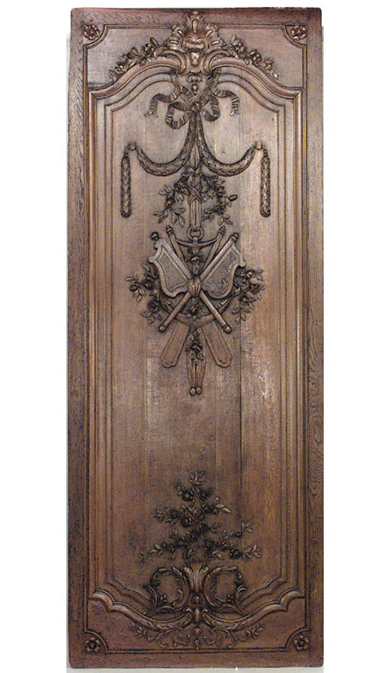 Important set of thirty-two French régence style oak paneled room with trophy carving. Approximately 50 running feet. (19th Cent)  Individual panel measurements:  29.5