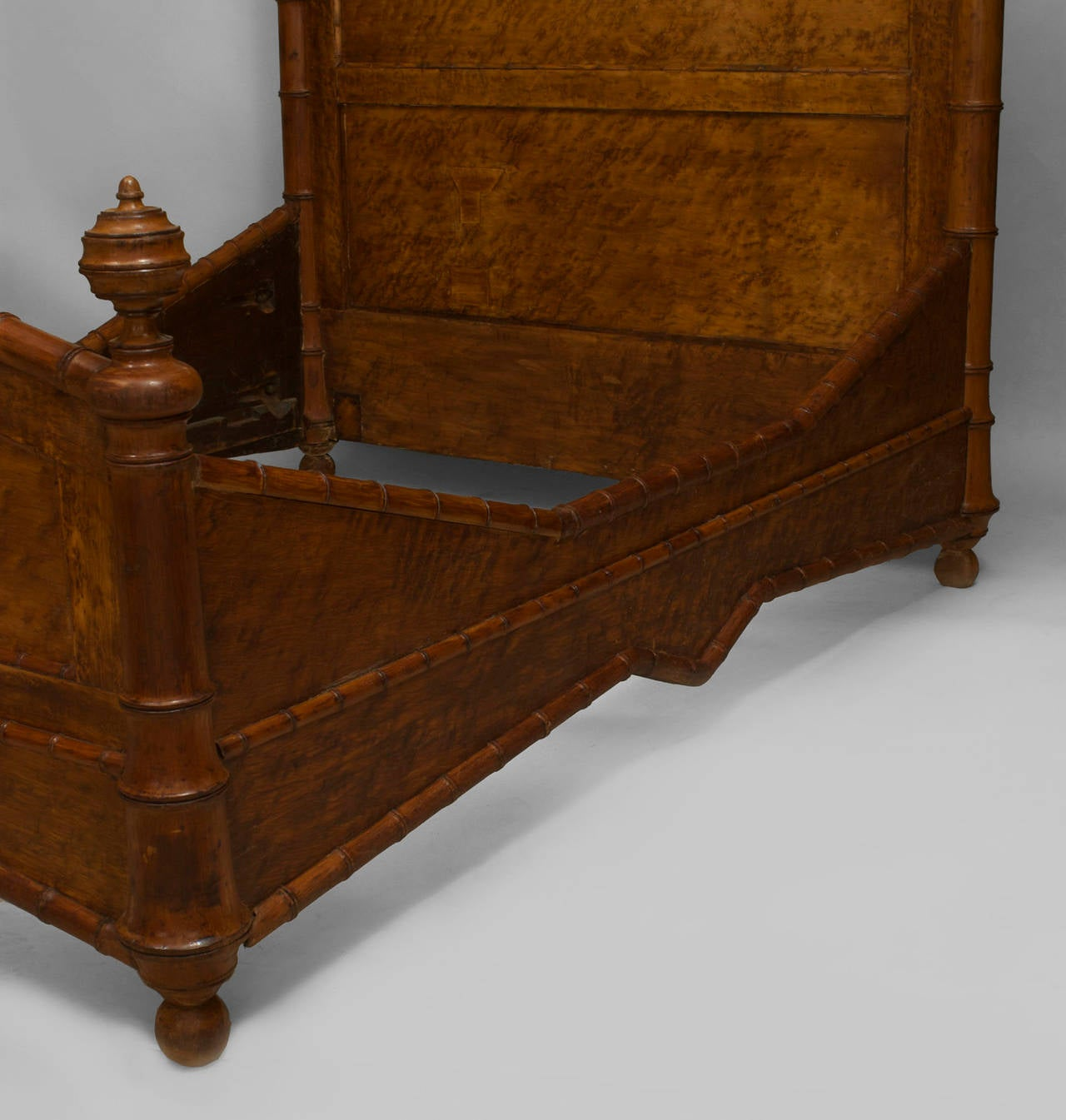 Late 19th century American Faux-Bamboo bird's eye maple queen-size bed with pediment top, finial sides, and faux bamboo carved trim (headboard, footboard, rails).