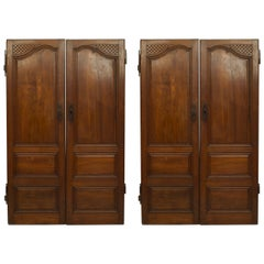 Pair of French Provincial Carved Walnut Doors