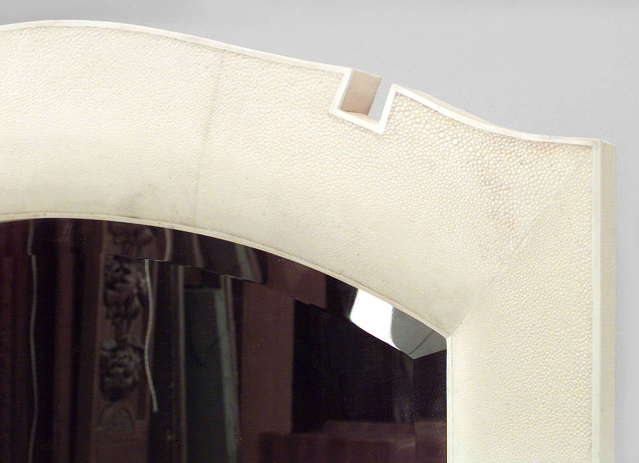 Modern French Art Deco style ream colored shagreen vertical wall mirrors with bone inlay and open pediment tops. (Priced each)
