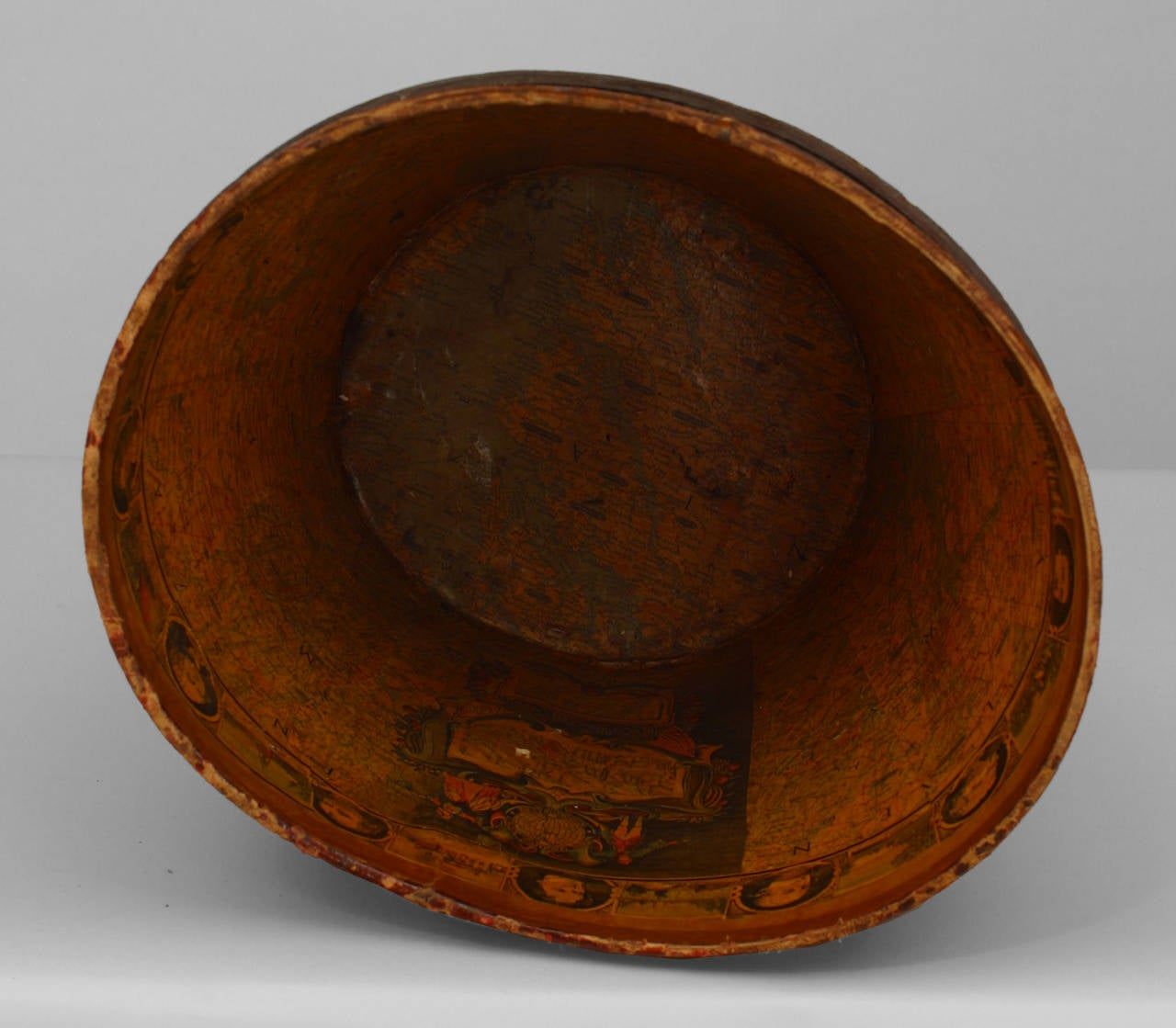 19th century American dark red leather top hat box with decoupage interior showing a map of America and portraits of 18/19th century notables. Please note that the box is missing its lid.