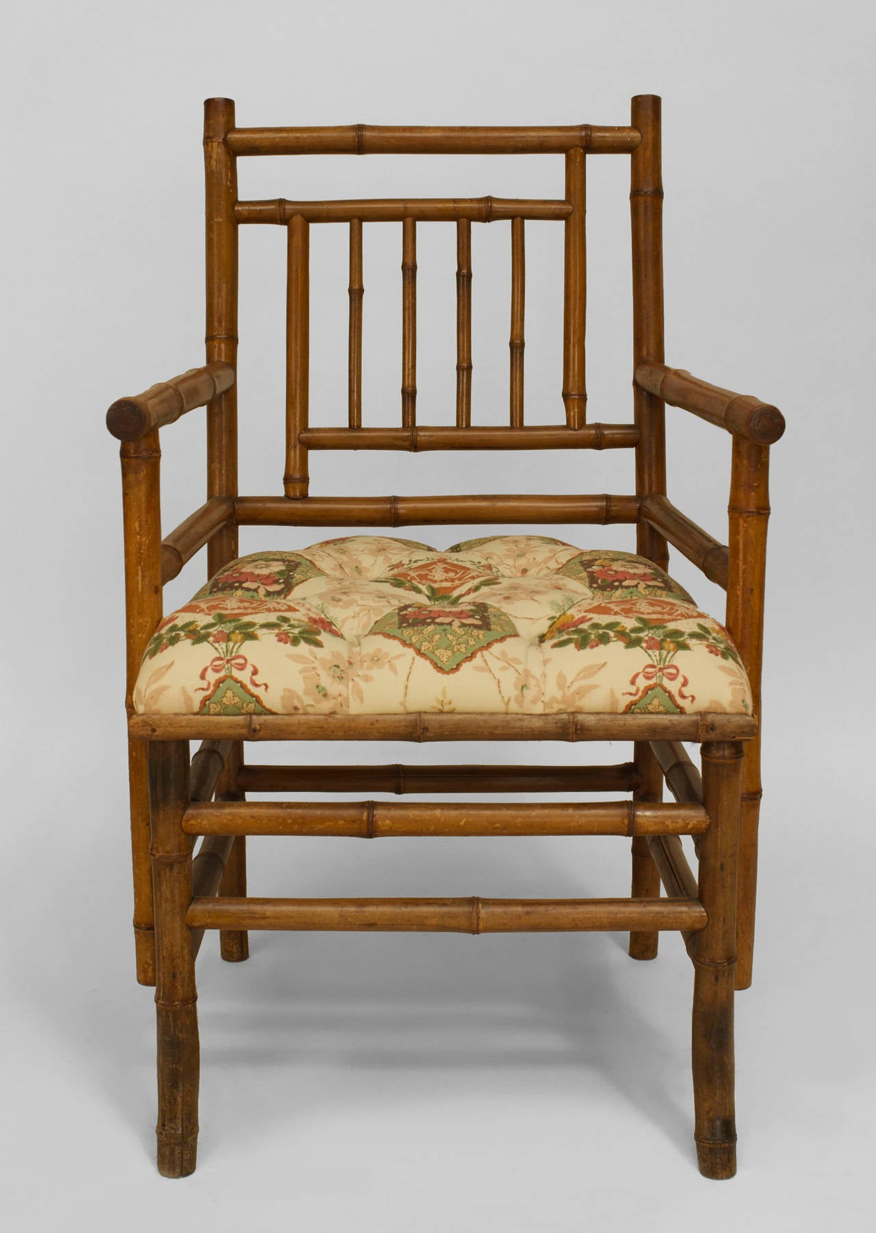 19th Century Bamboo Arm Chair Of Possible French Origin. The Chair Features  A Floral Upholstered
