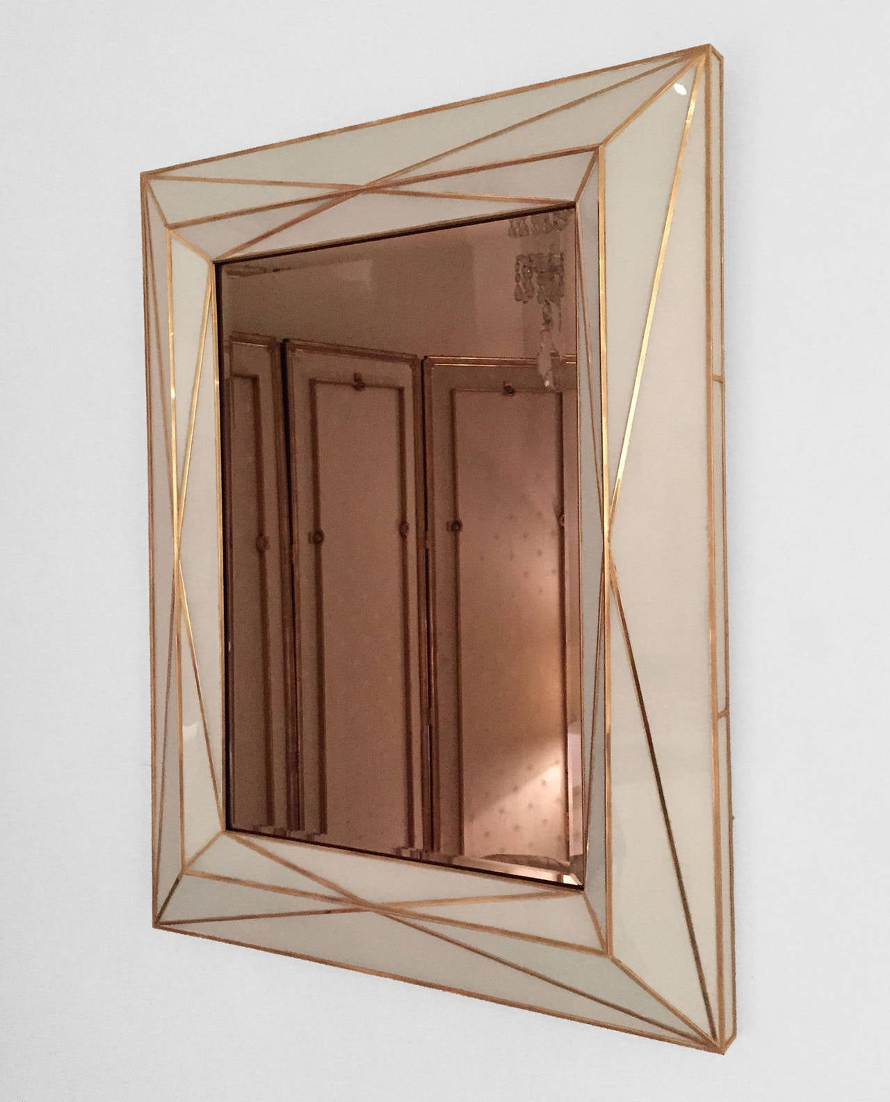 Modern American mirror with white colored glass and geometric brass inlay, the mirror itself is a smoked mirror.  Signed and numbered in a series of five.  Note: custom sizing and colors available.