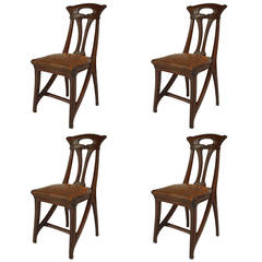 Set of Four French Art Nouveau Walnut and Leather Side Chairs by Gaillard