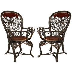 Pair of 19th c. Filigree Wicker And Red Velvet Fan Back Arm Chairs By Colt
