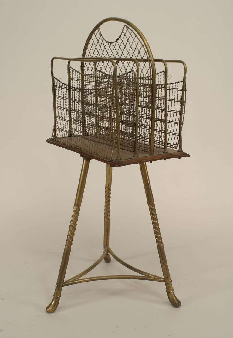 Nineteenth century English brass and wood book stand featuring a revolving top with a handle and four mesh dividers supported by a tripod base with twisted legs.