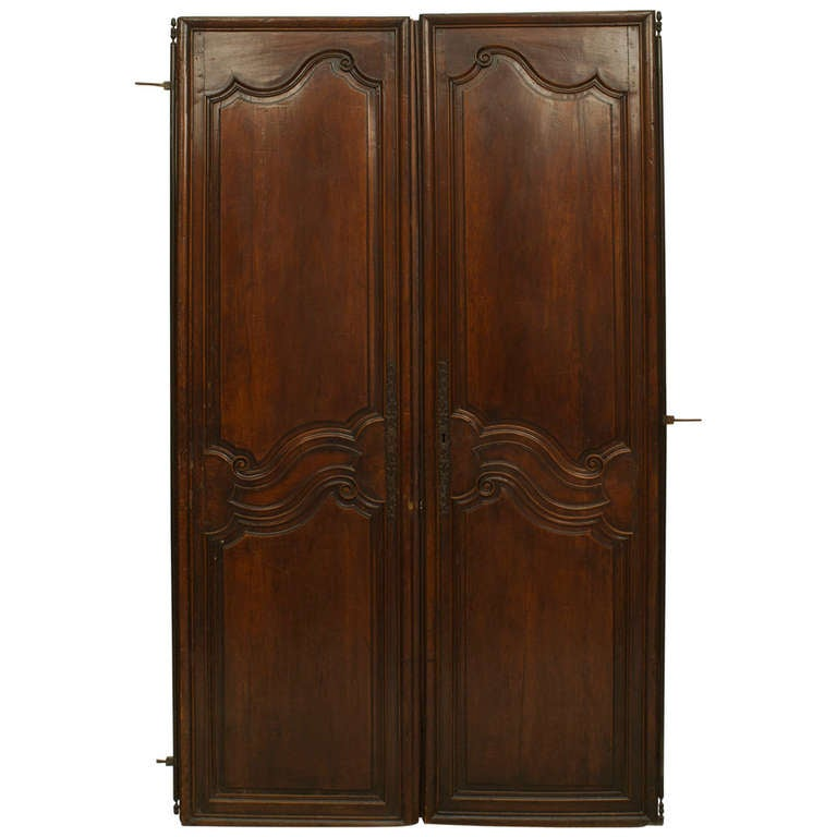 Pair of 18th Century French Provincial Carved Walnut Doors