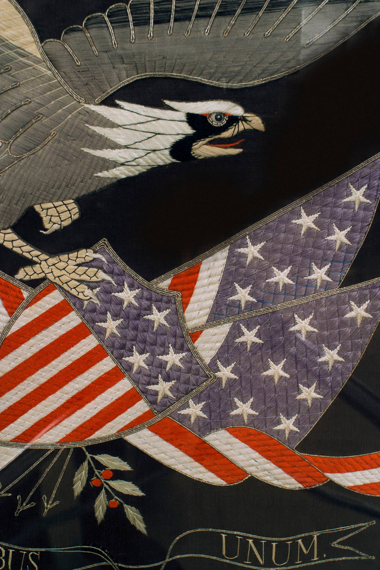 American (19th Cent) Federal style quilted silk embroidery of an eagle with a stars-and-stripes shield and flags with the motto: