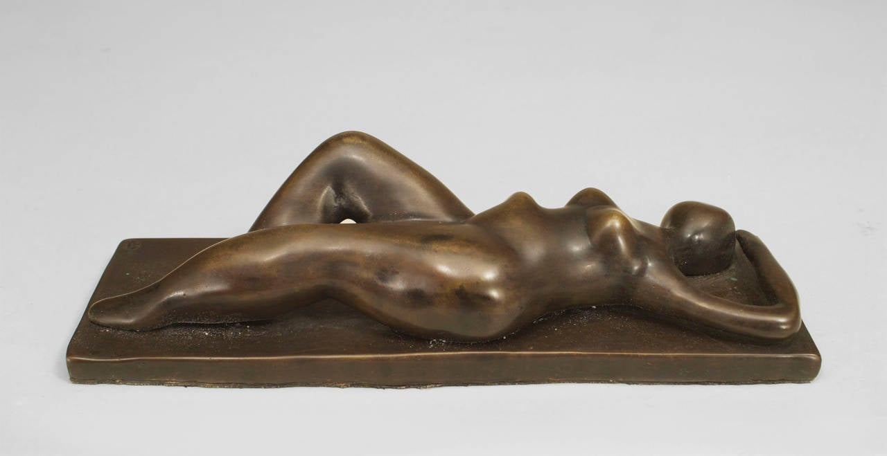 American Post-War Design bronze sculpture of female nude figure lying face up on rectangular base (with foundry mark)
