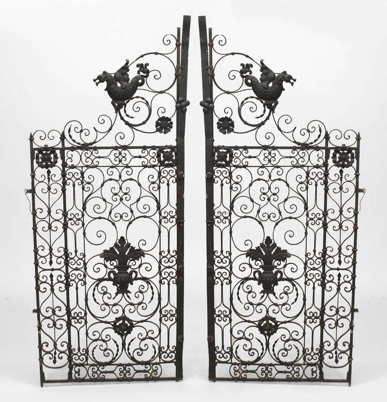Pair of 19th century Italian Renaissance style black painted iron gates featuring iron scroll, amphora, and serpent design motifs.