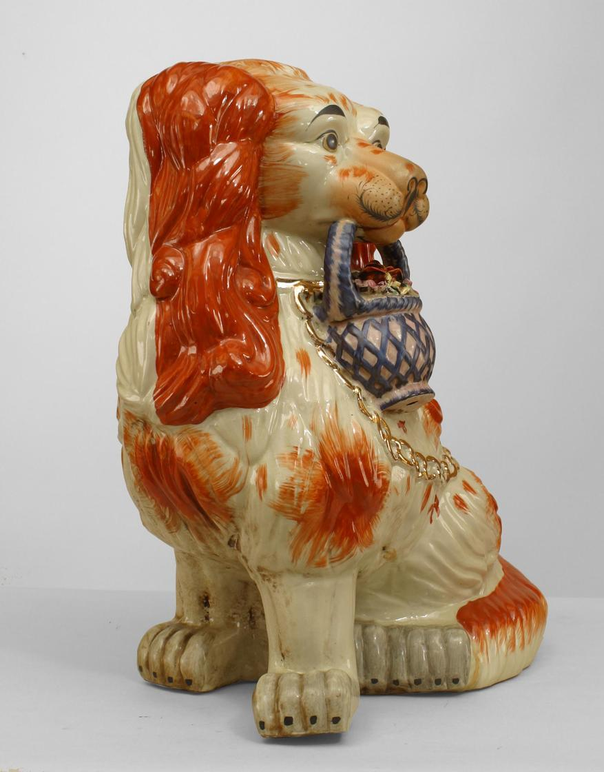 Pair of English Victorian style large porcelain Stafforshire porcelain figure of orange and white seated spaniel dogs holding baskets of flowers in their mouths with gold chain leashes.