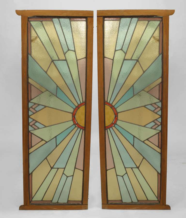 Pair of wood-framed leaded glass French doors that each represent half of a geometric & Pair of French Art Deco Stained Glass Doors at 1stdibs