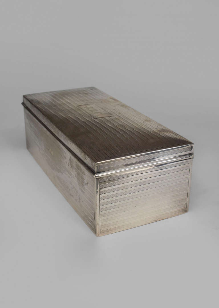 English Art Deco sterling silver cigarette box with an etched fluted design and hinged top bearing the inscribed initials