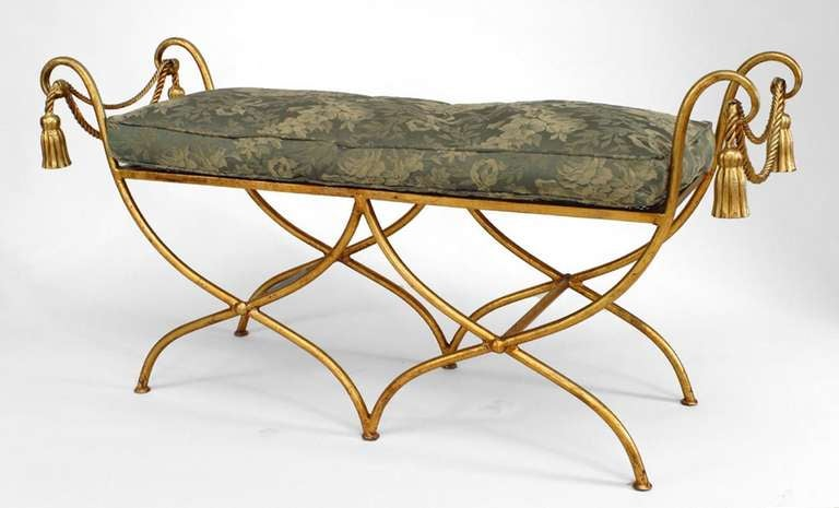 Art Moderne double seat rope and tassel design bench composed of gilt metal and featuring crossed legs, side arms and a mesh seat topped with a green patterned cushion.