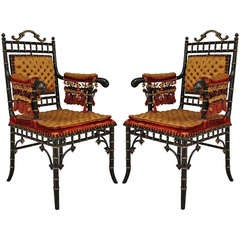 Pair of 19th c. Upholstered and Gilt Trimmed Faux Bamboo Armchairs