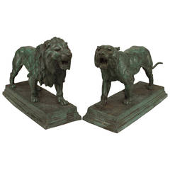 Pair of French Green Patinated Lion and Lioness Figures by Barye