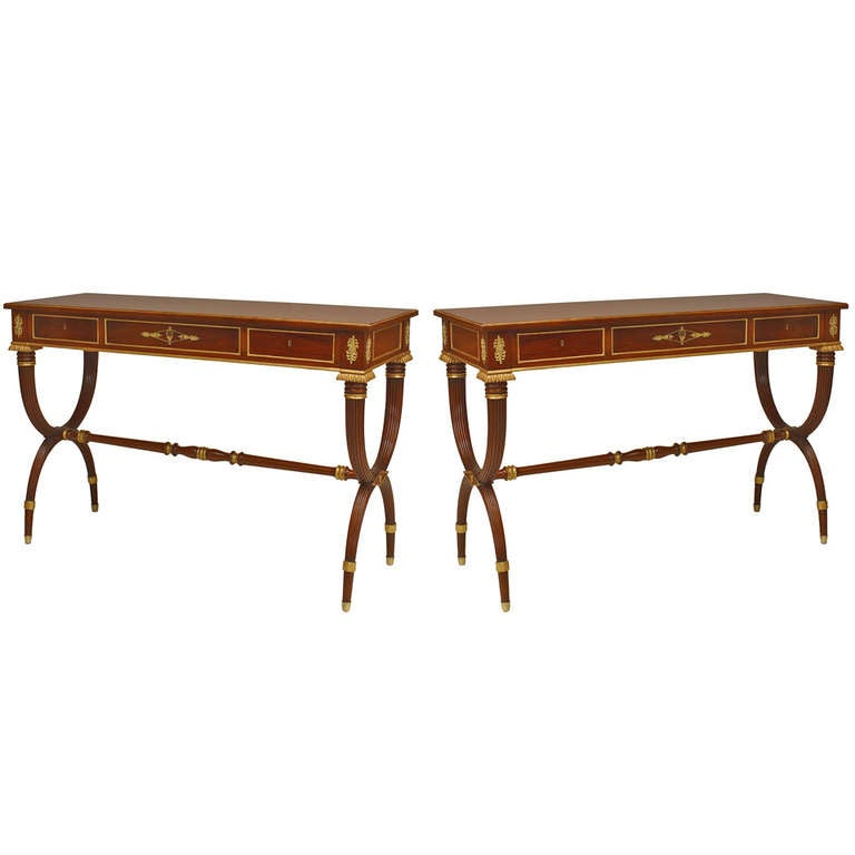 Pair of English Regency Gilt and Bronze Trimmed Mahogany Consoles