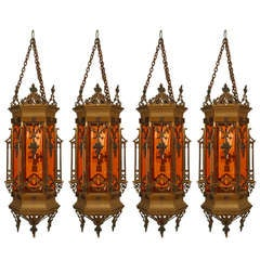 4 English Gothic Revival Bronze and Tinted Glass Hanging Lanterns