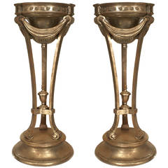 A Pair of American Neoclassical Iron Pedestal Planters, circa 1930