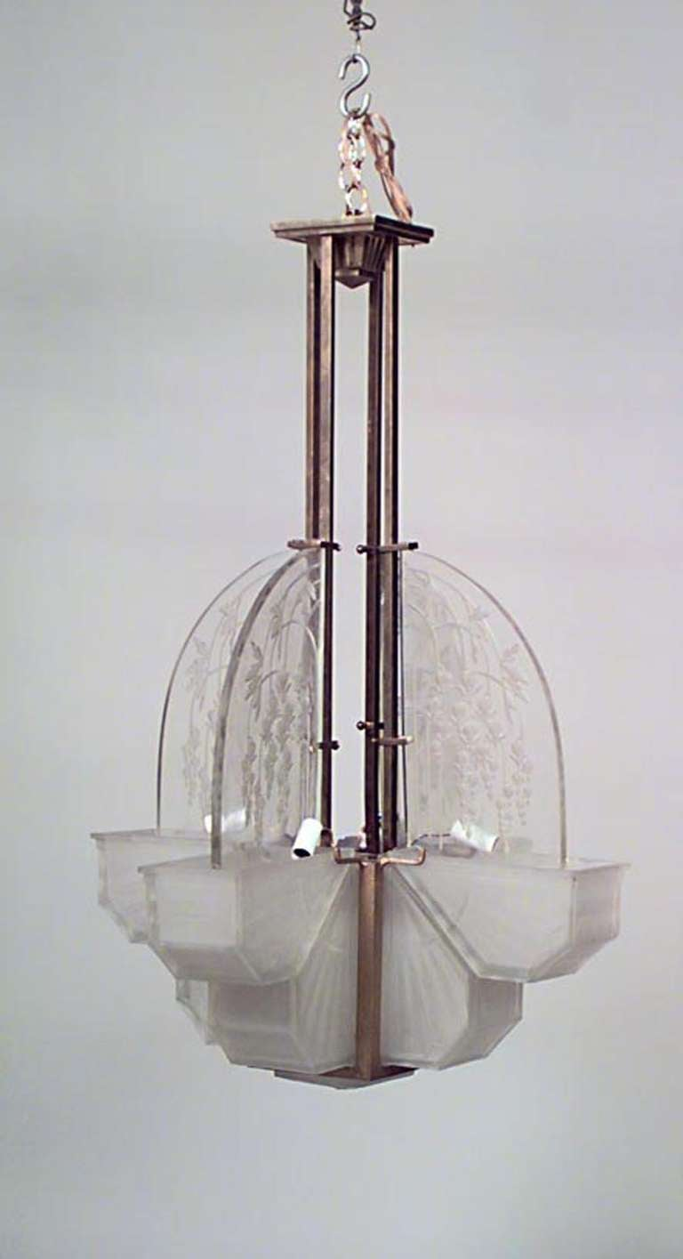 Signed by Atelier Vincent, this French Art Deco chandelier is composed of etched glass in a four corner design suspended by a long chrome shaft.