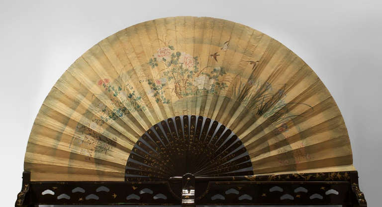 The Japanese folding fan mounted on a gilt chinoiserie lacquered base supporting a floral hand decorated paper panel. This piece was most certainly created for an exhibition most likely in London.