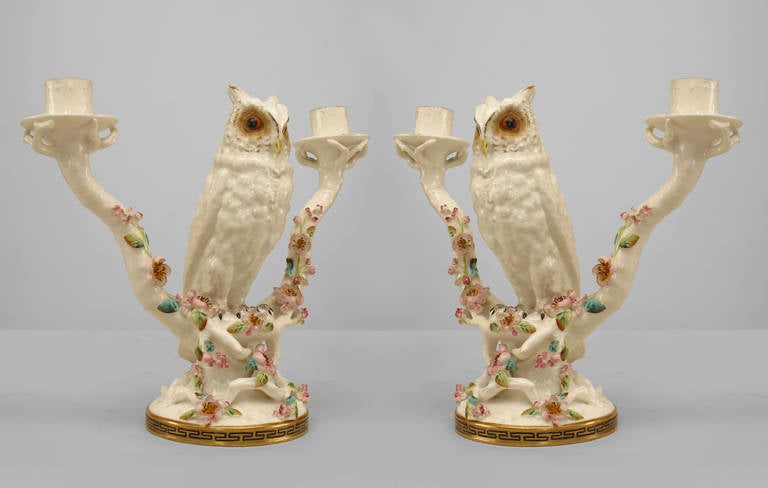 Pair of mid-19th century English porcelain two-arm candelabras designed in the form of owls propped upon blooming branches.