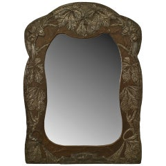 Art Nouveau Wall Mirror With an Embossed Foliate Design Metal Frame