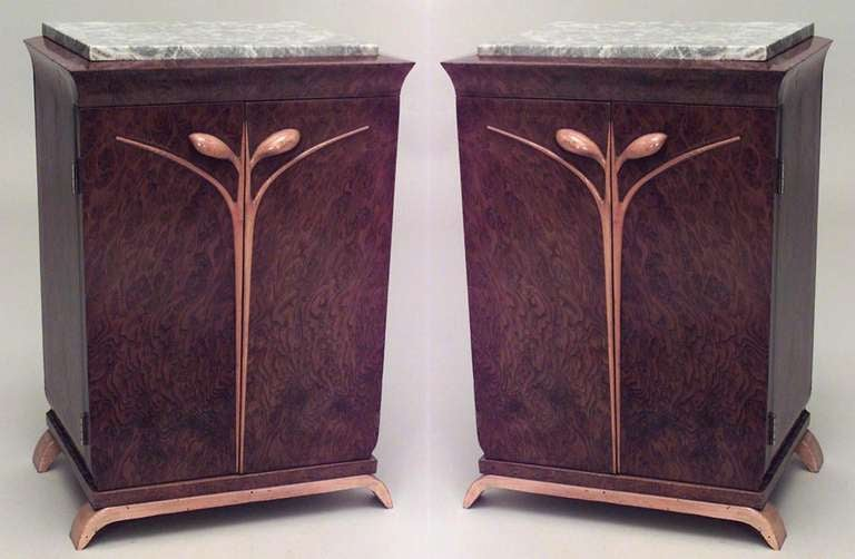 Pair of French Art Deco rectangular burl walnut bedside commodes crowned with rectangular grey tops and accented with stylized floral maple trim and curved maple feet. Each commode features a pair of doors that open at the center to reveal two