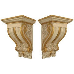 Two Sets of Neoclassical Painted and Gilt Trimmed Bracket Shelves