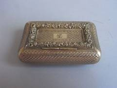 A George III Silver Gilt Curved Pocket Snuff Box made by Joseph Willmore.