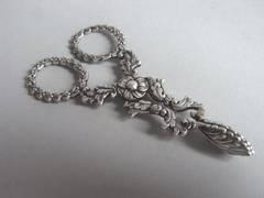 An unusual pair of George IV Sugar Nips made by Joseph Willmore.