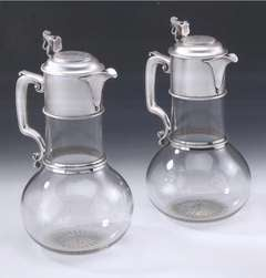 An exceptional pair of silver mounted Claret Jugs