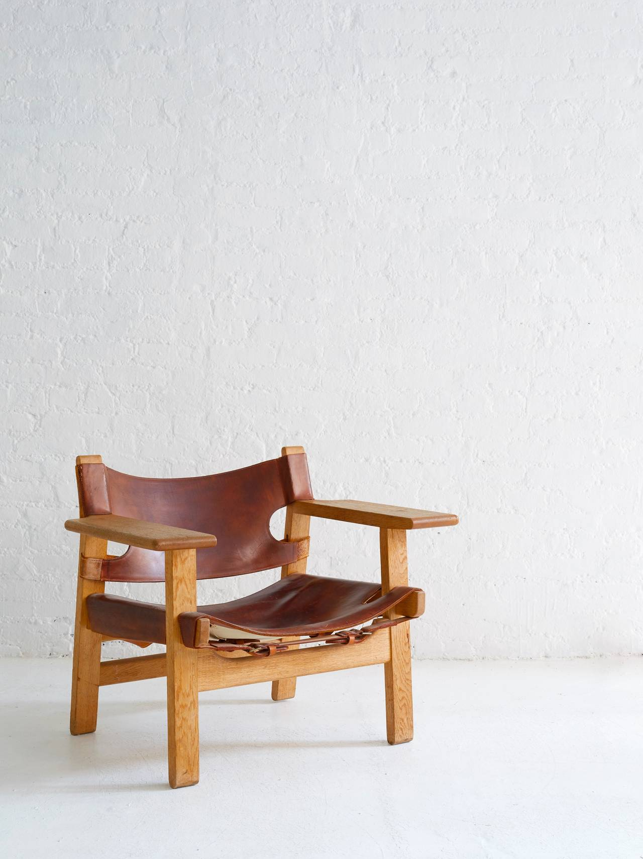 Iconic Borge Mogensen Spanish Chair with superlative patina.   Thick cognac leather is exquisite with age; beautiful oak frame.