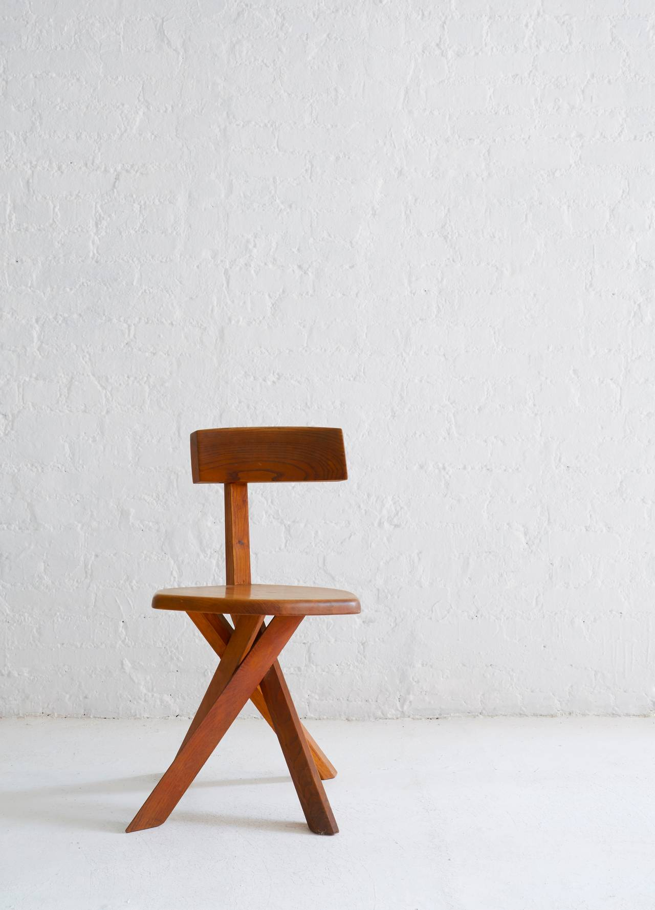 Pierre Chapo's famous solid oak asymmetrical chair with four twisted legs.