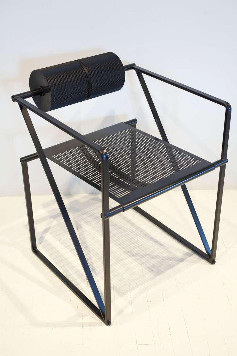 The geometric Botta Seconda 602 armchair. The seat features a perforated sheet metal which has bounced and unique spinning foam rollers.  1 remaining.