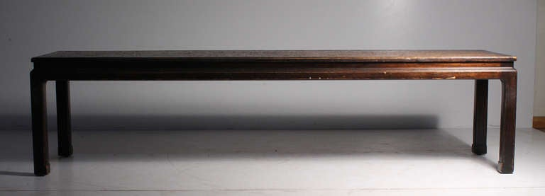 Early Edward Wormley Dunbar long oriental cork coffee table. Early green rectangular label attached. This version of this table is rarer in the longer length.  Measures: 62