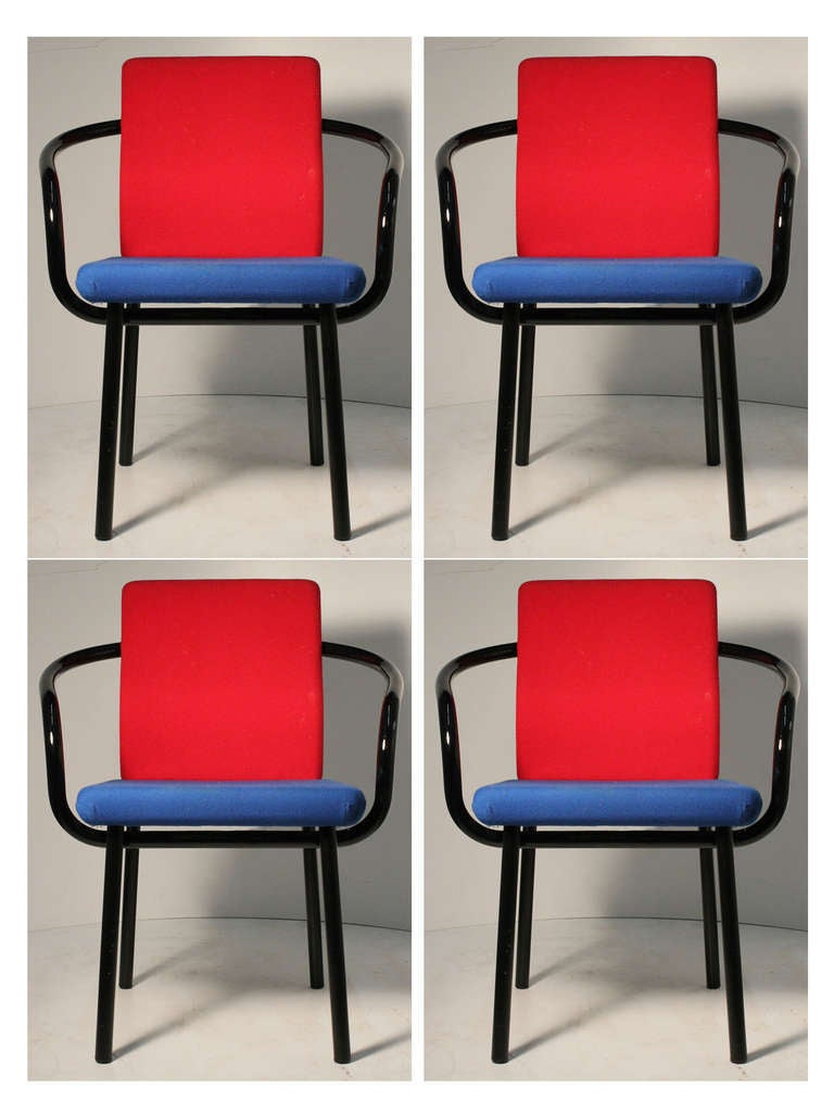 A set of 4 armchairs by Sottsass. Knoll labels attached.