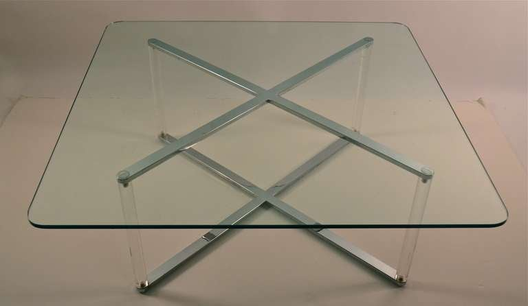 Stylish and sleek lucite base glass top coffee table, attributed to Charles Hollis Jones
