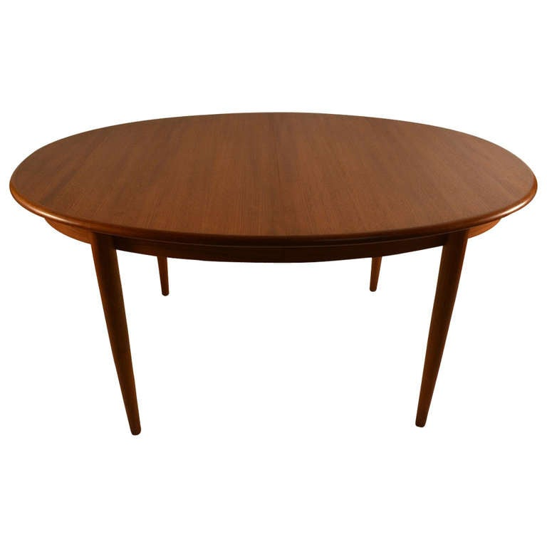Danish modern teak dining table at 1stdibs for Danish modern dining room table
