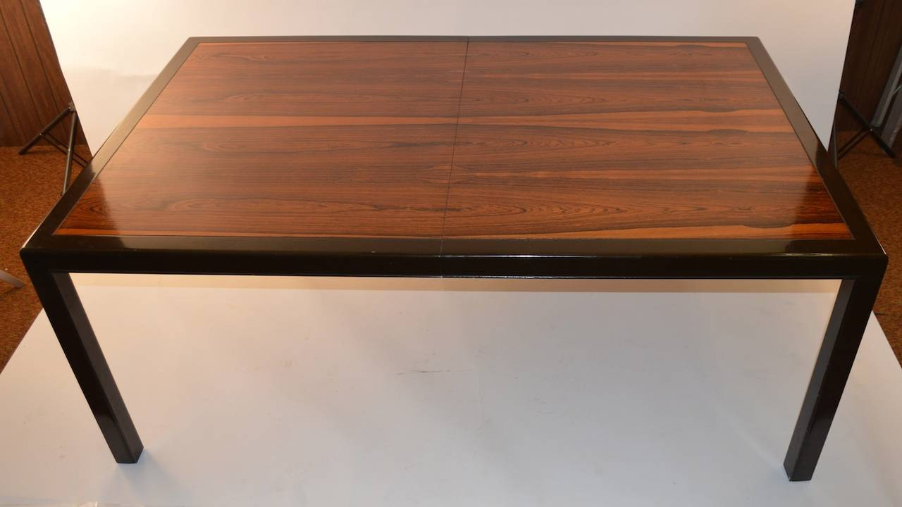 Dark Walnut frame, and legs, highly figured Rosewood top, this impressive table is 72