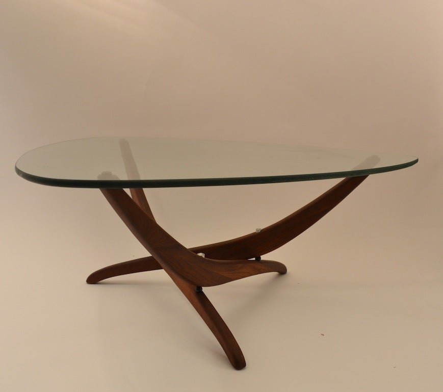 Elegant nickel plate triangular glass top table with for Designer cocktail tables glass