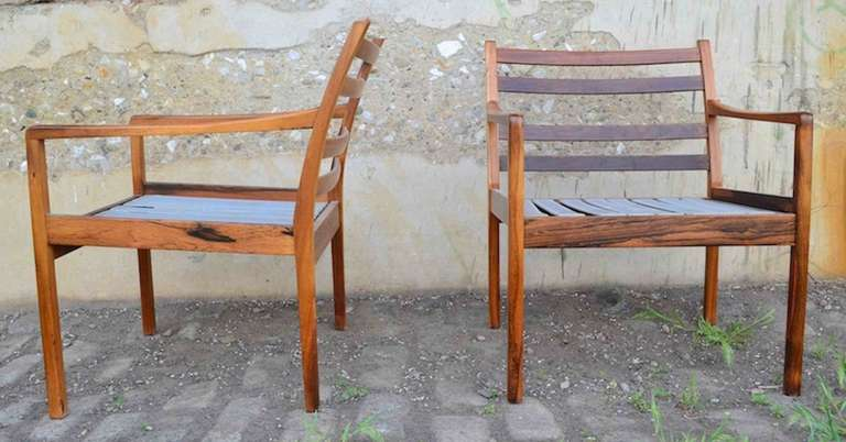 Fine pair of Ole Wanscher arm chairs, in original finish, with original cushions. Solid Rosewood construction.